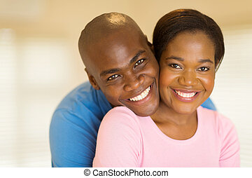 black couple looking at the camera
