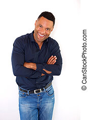 smiling black young man with arms crossed standing on white background