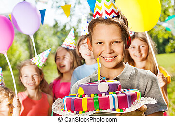 Portrait of smiling boy holding birthday cake