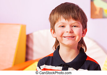 Portrait of smiling boy with happy expression