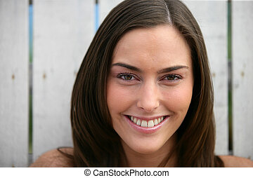 Portrait of smiling brown-haired woman
