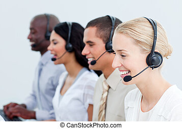 Portrait of smiling business people working in a call center