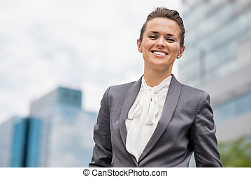 Portrait of smiling business woman in office district