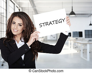 Portrait of smiling  business woman with board