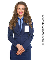 Portrait of smiling business woman with badge