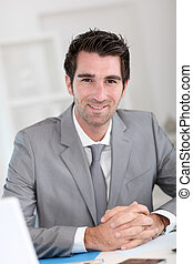 Portrait of smiling businessman at work