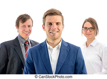 Portrait of Smiling Businessman Leader Looking at Camera on Background of Business People