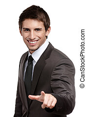 Portrait of smiling businessman pointing at you