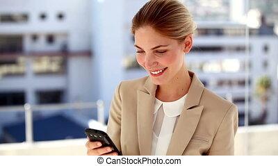 Portrait of smiling businesswoman texting