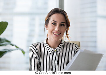 Portrait of smiling businesswoman looking at camera posing