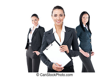 Portrait of smiling businesswoman with other two on background. Standing isolated on white