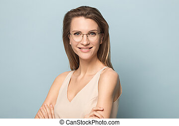Portrait of smiling Caucasian female model posing in glasses