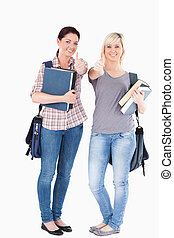 Portrait of smiling College students holding books