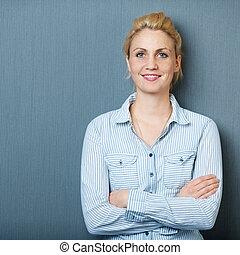 Portrait Of Smiling Confident Woman Against blue background
