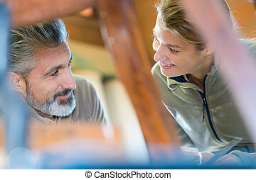 portrait of smiling couple at work