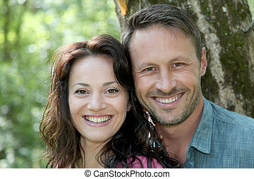 Portrait of smiling couple in forest