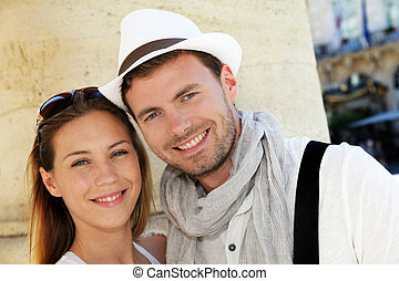 Portrait of smiling couple in town