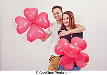 Portrait of smiling couple with balloons heart