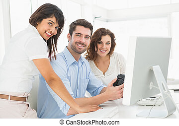 Portrait of smiling coworkers posing together in the office