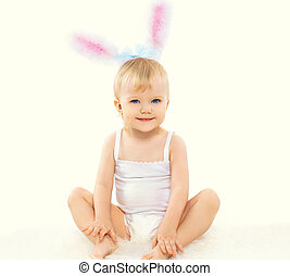 Portrait of smiling cute baby in costume easter bunny with fluffy ears