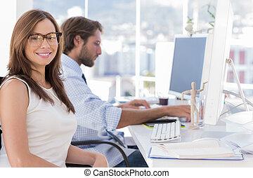 Portrait of smiling designer with reading glasses