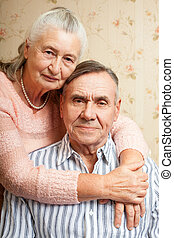 Portrait of smiling elderly couple Old people holding hands. Senior man, woman. Concept of marital fidelity, providing for old age, reliability, care for the elderly, love confession.