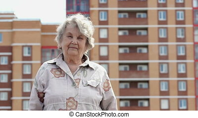 Portrait of smiling elderly mature woman outdoors