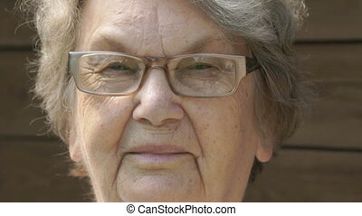 Portrait of smiling elderly woman in glasses