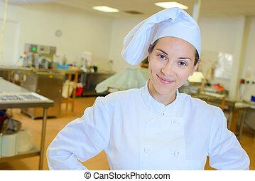 Portrait of smiling female chef