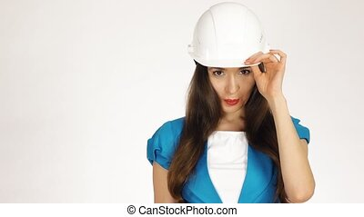 Portrait of smiling female construction engineer or architect in hard hat against white background. 4K video
