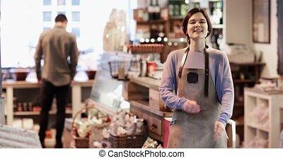 Portrait Of Smiling Female Owner Of Delicatessen Shop...