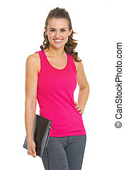 Portrait of smiling fitness young woman with clipboard