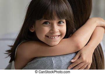 Portrait of smiling girl hug cuddle with young mom - ...
