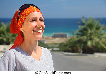 Portrait of smiling girl in red kerchief and sunglasses...