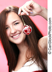 smiling girl in red with Christmas decoration