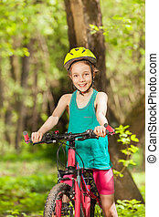 Portrait of smiling girl riding her mountain bike