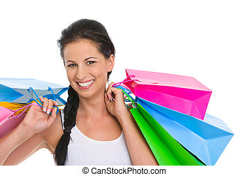 Portrait of smiling girl with shopping bags