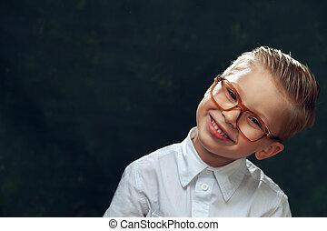 Portrait of smiling handsome boy wearing glasses