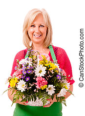 Portrait of smiling happy florist with green apron isolated on white