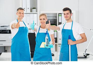 Portrait Of Smiling Janitors