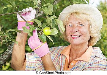 Portrait of smiling lady at backyard garden