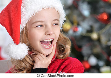 girl with Christmas hat on