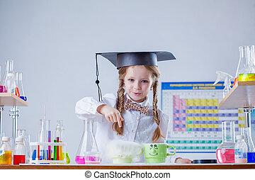 Portrait of smiling little scientist in laboratory