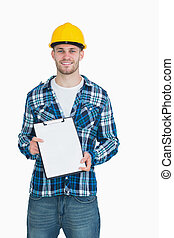 Portrait of smiling male architect holding clipboard