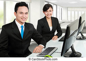 smiling man and woman office worker
