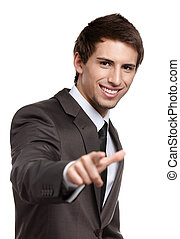 Portrait of smiling man pointing at you