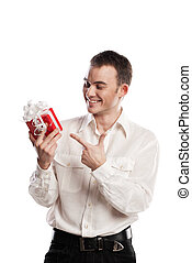 portrait of smiling man pointing on gift on white