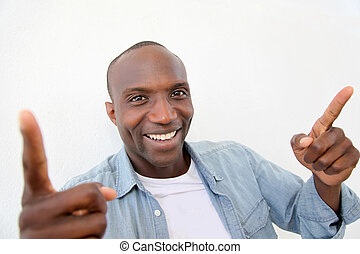 Portrait of smiling man showing thumbs up