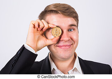 Portrait of smiling man with bitcoin instead of eye