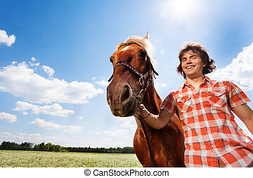 Portrait of smiling man with his beautiful horse